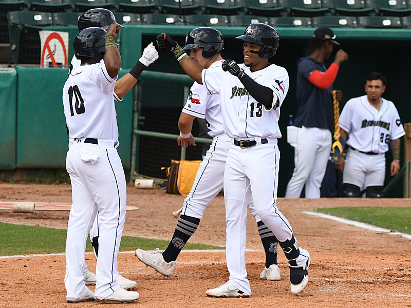 San Antonio Missions teammates celebrate after Jose Azocar (13) hit a three-run homer in the second inning of a 6-1 victory over the Amarillo Sod Poodles on Sunday at Wolff Stadium. - photo by Joe Alexander