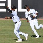 San Antonio Missions center fielder Jose Azocar catches a fly ball in front of left fielder Esteury Ruiz on Sunday at Wolff Stadium. - photo by Joe Alexander