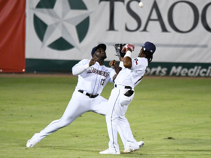 Jorge Ona (left) makes a catch in short left field behind San Antonio Missions shortstop Eguy Rosario on Tuesday at Wolff Stadium. - photo by Joe Alexander