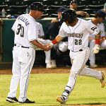 Juan Fernandez is congratulated by San Antonio Missions manager/third base coach Phillip Wellman after hitting his seventh home run of the season on Tuesday at Wolff Stadium. - photo by Joe Alexander