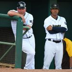 San Antonio Missions manager Phillip Wellman (left) and coach Freddy Flores in the dugout Sunday at Wolff Stadium. - photo by Joe Alexander