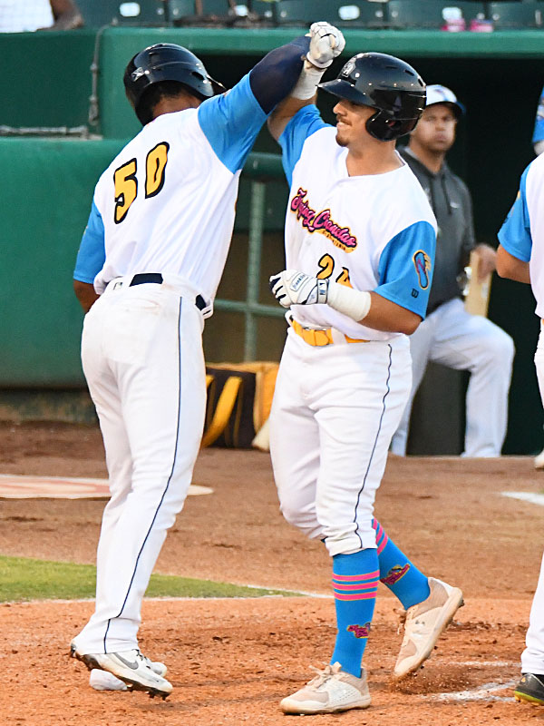 Michael Curry (right) and Allen Cordoba celebrate near home plate after they both scored on Curry's home run on Thursday at Wolff Stadium. - photo by Joe Alexander
