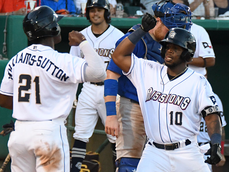 The San Antonio Missions' Dwanya Williams-Sutton (left) greets Olivier Basabe at the plate after they both scored on Basabe's fifth-inning home run on Sunday at Wolff Stadium. - photo by Joe Alexander