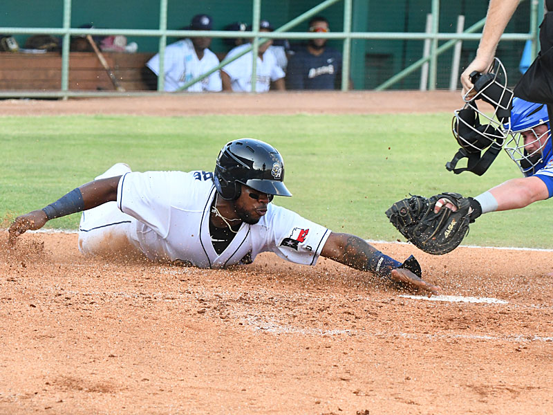Olivier Basabe slides into home on Eguy Rosario's sacrifice fly to score the San Antonio Missions' second run in Wednesday's first game at Wolff Stadium. - photo by Joe Alexander