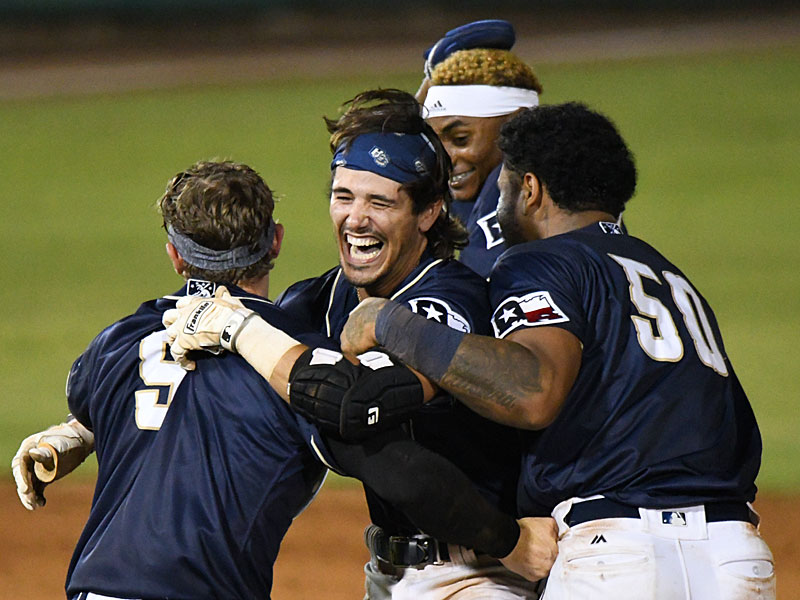 The Missions' Ethan Skender (center) celebrates with teammates after his walk-off hit in Wednesday's second game at Wolff Stadium. - photo by Joe Alexander