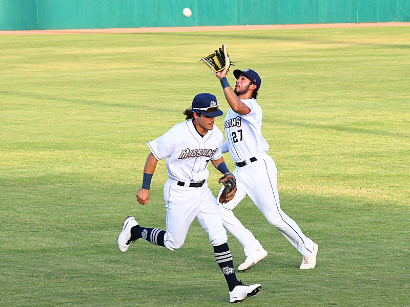 San Antonio Missions right fielder Agustin Ruiz catches a short fly ball behind Missions second baseman Ethan Skender on Saturday at Wolff Stadium. - photo by Joe Alexander