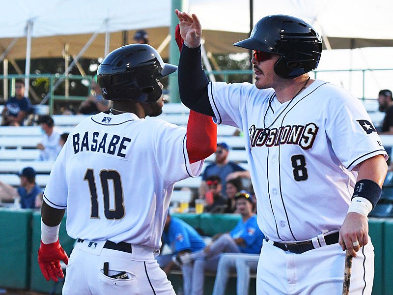 The San Antonio Missions Olivier Basabe is congratulated by Kyle Overstreet after Basabe hit a three-run homer in the third inning on Sunday at Wolff Stadium. - photo by Joe Alexander