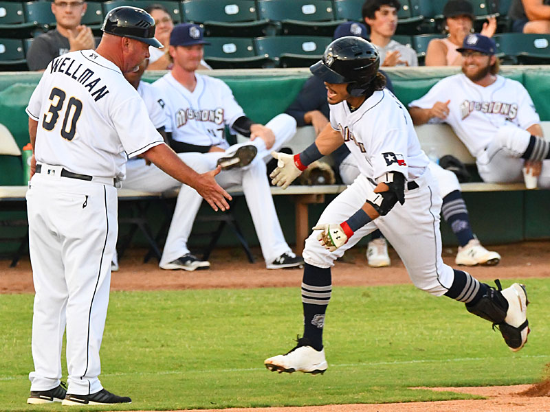 San Antonio Missions second baseman Ethan Skender is congratulated by manager/third base coach Phillip Wellman for hitting a home run on Tuesday at Wolff Stadium. - photo by Joe Alexander