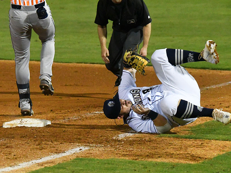 San Antonio Missions first baseman Kyle Overstreet tumbles after tagging the base for a force out on Wednesday at Wolff Stadium. - photo by Joe Alexander