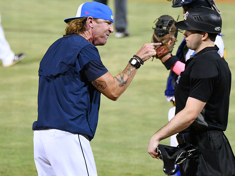 San Antonio Missions pitching coach Pete Zamora talks to the home plate umpire after Zamora was ejected in the eighth inning on Thursday at Wolff Stadium. - photo by Joe Alexander